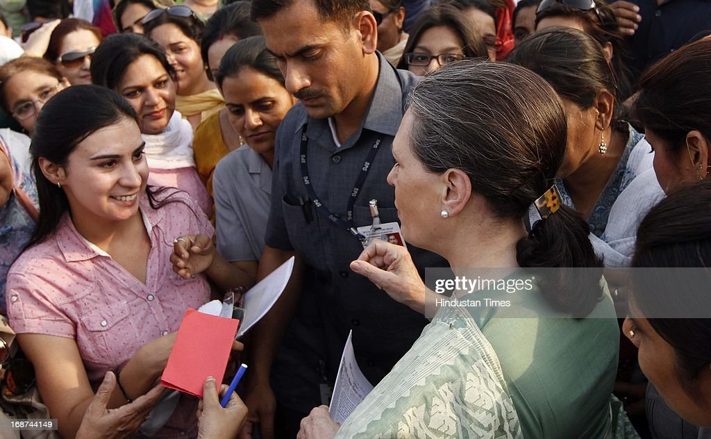 UPA Chairperson and Congress President Sonia Gandhi meets students after laying the foundation stone for a girls' hostel at Jamia Millia Islamia University on May 14, 2013 in New Delhi, India.