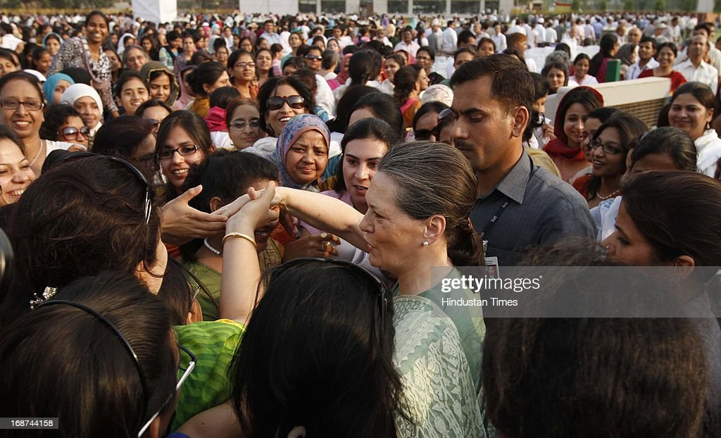 UPA Chairperson and Congress President Sonia Gandhi shakes hands with students after laying the foundation stone for a girls' hostel at Jamia Millia Islamia University on May 14, 2013 in New Delhi, India.