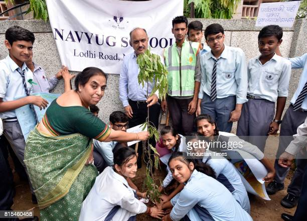 Chairperson Naresh Kumar during the plantation drive at Navyug School Lodhi Colony on July 15 2017 in New Delhi India The New Delhi Municipal Council...