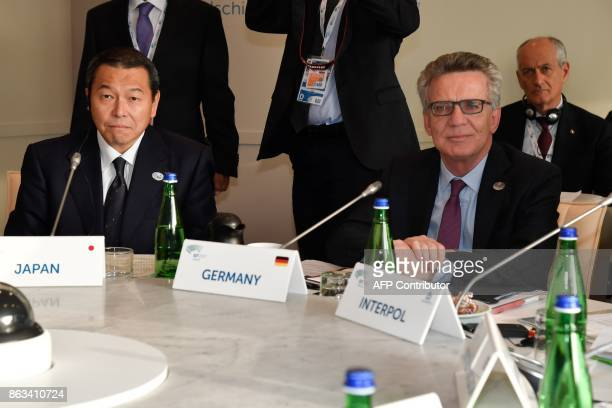 Chairperson of Japan's National Public Safety Commission Achiro Hoconogi and Germany's Interior Minister Thomas de Maiziere attend before a working...