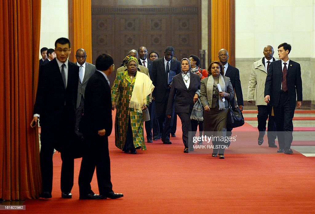 Chairperson of the African Union Commission, Dr Nkosazana Dlamini-Zuma (4th L) arrives to meet the Chinese Communist Party Secretary General and the countries new leader Xi Jinping at the Great Hall of the People in Beijing on February 17, 2013. The South African recently took over as head of the African Union Commission, becoming the first woman at the helm of the pan-African bloc's executive committee. Dlamini-Zuma, an ex-wife of South African President Jacob Zuma, was previously the South African home affairs minister. AFP PHOTO/Mark RALSTON