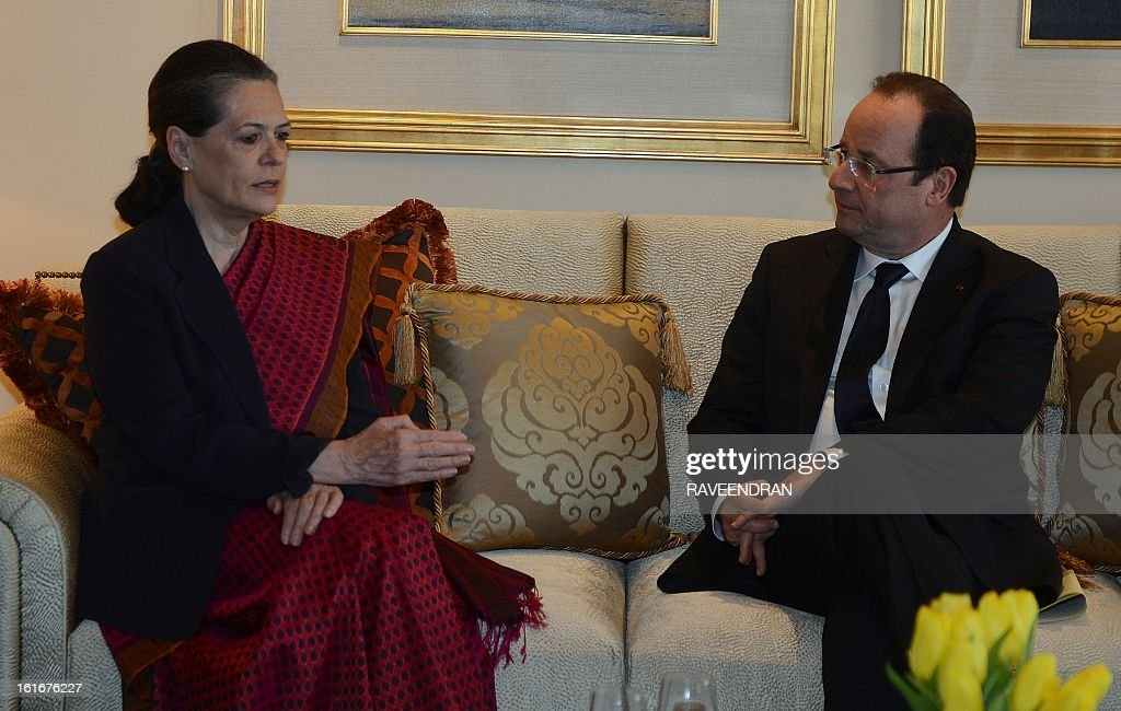 Chairperson of the Congress-led UPA government, Sonia Gandhi (L) talks with France's President Francois Hollande during a meeting in New Delhi on February 14, 2013. French President Francois Hollande embarked on a fresh push to clinch a USD 12-billion sale of Rafale fighter jets as he held talks in India on his first visit to Asia since taking office. The Socialist president was accompanied by a high-powered delegation of five ministers including Foreign Minister Laurent Fabius and Defence Minister Jean-Yves Le Drian and the chiefs of more than 60 top French companies. AFP PHOTO/RAVEENDRAN