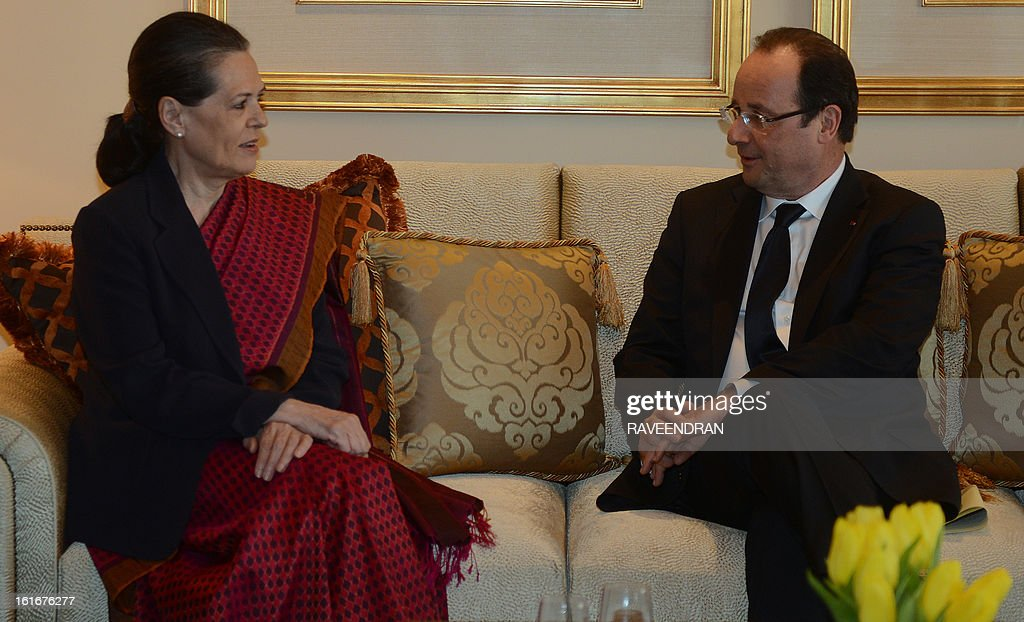 Chairperson of the Congress-led UPA government, Sonia Gandhi (L) talks with France's President Francois Hollande during a meeting in New Delhi on February 14, 2013. French President Francois Hollande embarked on a fresh push to clinch a USD 12-billion sale of Rafale fighter jets as he held talks in India on his first visit to Asia since taking office. The Socialist president was accompanied by a high-powered delegation of five ministers including Foreign Minister Laurent Fabius and Defence Minister Jean-Yves Le Drian and the chiefs of more than 60 top French companies.