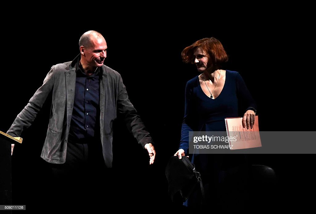 Chairperson of the German party 'Die Linke' Katja Kipping arrives on a stage next to Greek former Finance Minister Yanis Varoufakis during an event to mark the official launch of the Democracy in Europe Movement (DiEM) in Berlin on February 9, 2016. / AFP / TOBIAS SCHWARZ