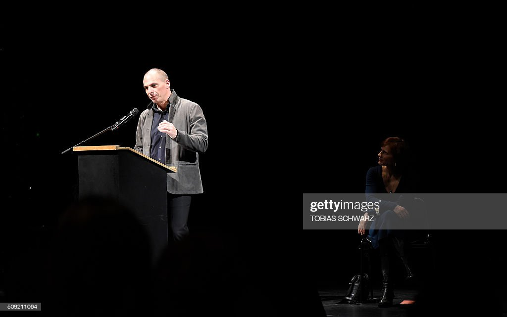 Chairperson of the German party 'Die Linke' Katja Kipping listens to Greek former Finance Minister Yanis Varoufakis during an event to mark the official launch of the Democracy in Europe Movement (DiEM) in Berlin on February 9, 2016. / AFP / TOBIAS SCHWARZ