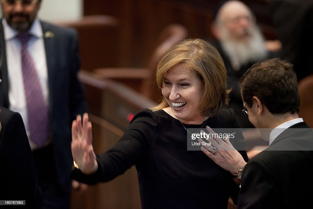 Chairperson of The Movement (HaTnuah) party and former Israeli foreign minister <a gi-track='captionPersonalityLinkClicked' href=/galleries/search?phrase=Tzipi+Livni&family=editorial&specificpeople=537394 ng-click='$event.stopPropagation()'>Tzipi Livni</a> attends the swearing-in ceremony of the 19th Knesset, the new Israeli parliament, on February 5, 2013 in Jerusalem, Israel. The 120 members included a record 48 new law makers.