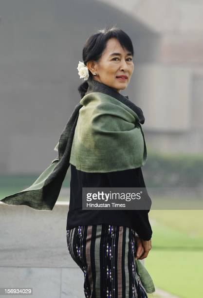 Chairperson of The National League for Democracy of Myanmar Aung San Suu Kyi smiles after paying tribute at Rajghat The Memorial to Mahatma Gandhi on...