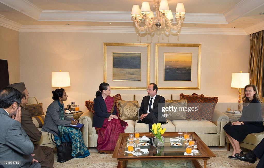 Chairperson of the ruling United Progressive Alliance, Sonia Gandhi (C-L) meets with France's President Francois Hollande (C-R) at the Tal Palace hotel in New Delhi on February 14, 2013. French President Francois Hollande made a fresh push Thursday to clinch the world's biggest defence deal, the $12 billion sale of 126 warplanes to India, during his first visit to Asia since taking office.