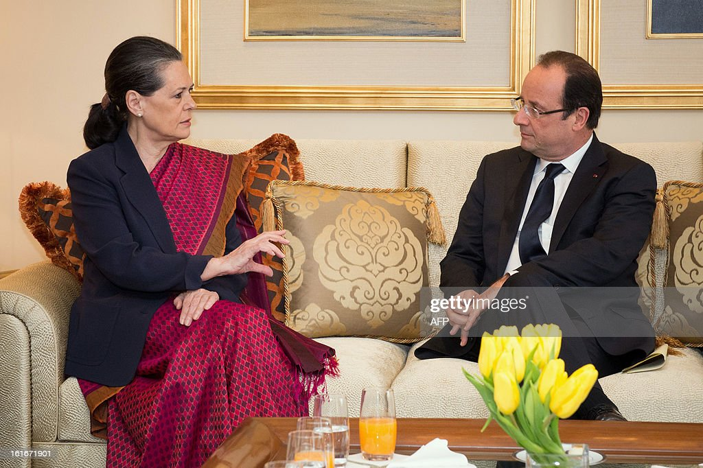 Chairperson of the ruling United Progressive Alliance, Sonia Gandhi (L) meets with France's President Francois Hollande at the Tal Palace hotel in New Delhi on February 14, 2013 during the French President's two-day visit. French President Francois Hollande made a fresh push Thursday to clinch the world's biggest defence deal, the $12 billion sale of 126 warplanes to India, during his first visit to Asia since taking office.