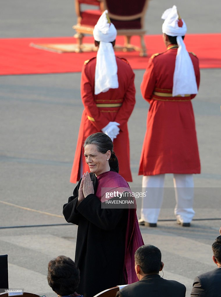 Chairperson of the UPA government and Congress Party president Sonia Gandhi (C) arrives for the Beating Retreat Ceremony at Vijay Chowk in New Delhi on January 29, 2013. The ceremony is a culmination of Republic Day celebrations and dates back to the days when troops disengaged themselves from battle at sunset.