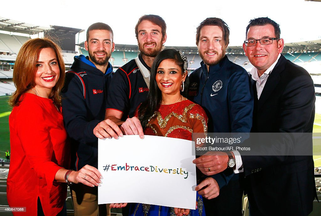 Chairperson of the Victorian Multicultural Commission Helen Kapalos, Jimmy Toumpas of the Demons, Jobe Watson of the Bombers, Dale Thomas of the Blues and Premier of Victoria Daniel Andrews hold an 'embrace diversity' sign during during the AFL Multicultural Round launch at the Melbourne Cricket Ground on July 16, 2015 in Melbourne, Australia.