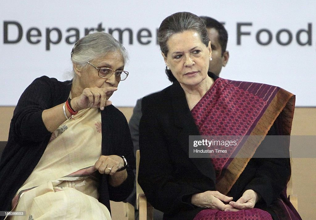 UPA Chairperson Sonia Gandhi and Delhi Chief Minister Sheila Dikshit during the launch of the Delhi Annshree Yojana on December 15, 2012 in New Delhi, India. Under the scheme monthly cash subsidy of Rs 600 will be transferred directly into bank account of senior-most female member of two lakh poor families.