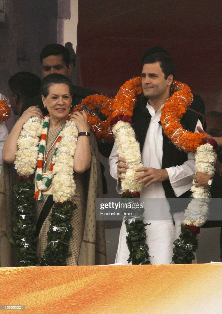 Chairperson Sonia Gandhi and party's General Secretary Rahul Gandhi (R) receive garlands during the Congress Maharally at Ram Lila Maidan on November 04, 2012 in New Delhi, India. The rally is expected to set the agenda for the party's one-day brainstorming session at Surajkund on November 9 in which it plans to discuss the current political and economic situation.