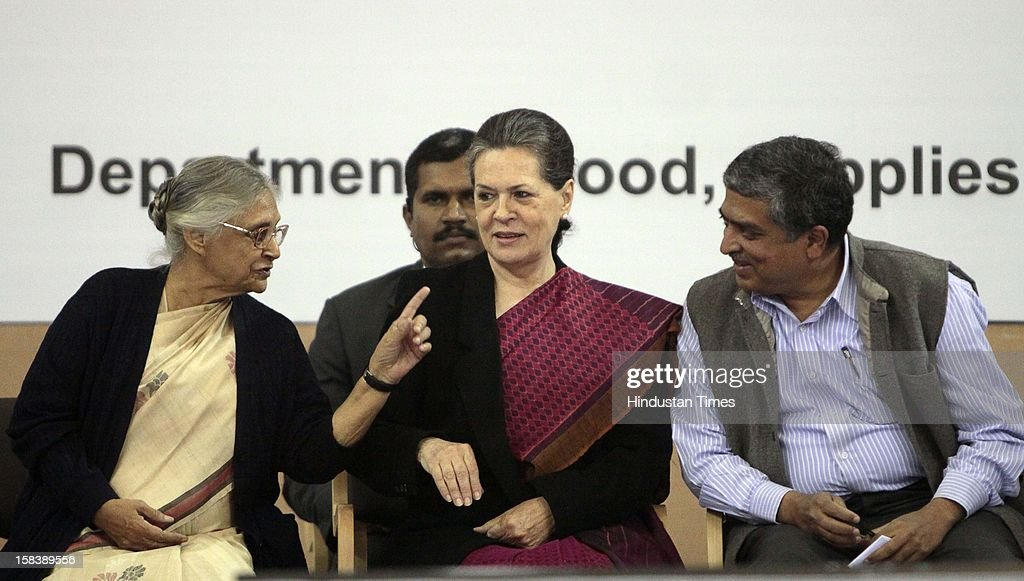UPA Chairperson Sonia Gandhi, Delhi Chief Minister Sheila Dikshit and UIDAI Chairman Nandan Nilekani during the launch of the Delhi Annshree Yojana on December 15, 2012 in New Delhi, India. Under the scheme monthly cash subsidy of Rs 600 will be transferred directly into bank account of senior-most female member of two lakh poor families.