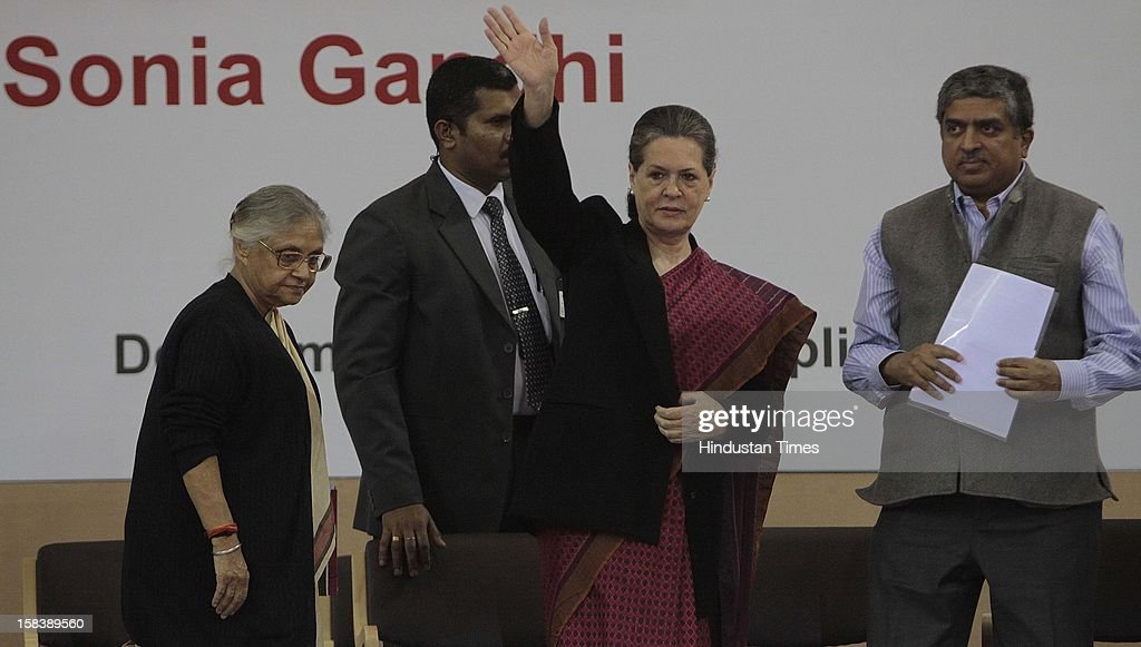 UPA Chairperson Sonia Gandhi, Delhi Chief Minister Shiela Dixit and Nandan Nilekani (R) Chairman of the new Unique Identification Authority of India during the launch of the Delhi Annshree Yojana on December 15, 2012 in New Delhi, India. Under the scheme monthly cash subsidy of Rs 600 will be transferred directly into bank account of senior-most female member of two lakh poor families.