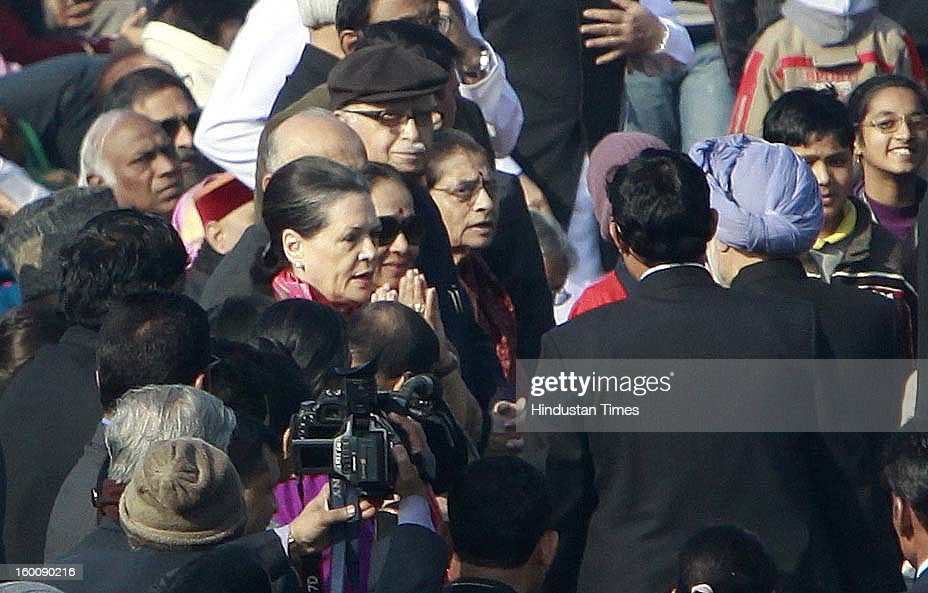 UPA Chairperson Sonia Gandhi Greeting the Prime Minster of India Manmohan singh during the 64th Republic Day parade celebration at Raj path on January 26, 2013 in New Delhi, India. India marked its Republic Day with celebrations held under heavy security, especially in New Delhi where large areas were sealed off for an annual parade of military hardware.