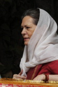 Chairperson Sonia Gandhi holds a Chadar that is to be sent to the shrine of Sufi saint Khwaja Moinuddin Chishti at Ajmer at her residence on May 22...