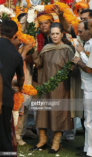Chairperson Sonia Gandhi is garlanded during launch of a 'Shobha Yatra' on the occasion of Maharishi Valmiki Jayanti on October 29 2012 in New Delhi...