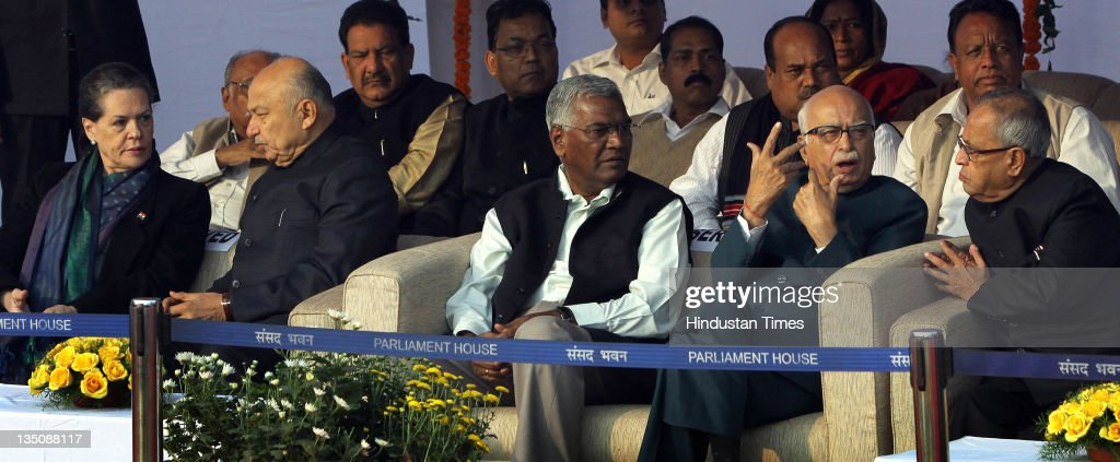 UPA Chairperson Sonia Gandhi, Minister of Power Sushilkumar Shinde, CPI Leader D Raja, BJP Leader Lal Krishna Advani and Finance Minister Pranab Mukherjee attend a floral tribute to Bodhisatva Babasaheb Dr.B.R. Ambedkar on his 56th Mahaparinirvan Diwas on the Parliament House Lawns on December 6, 2011 in New Delhi, India. Amongst tight security Indian political leaders paid homage to B.R. Ambedkar by laying floral tributes at the statue of Baba Saheb near Parliment House on his 56th Mahaparinirvan Diwas.