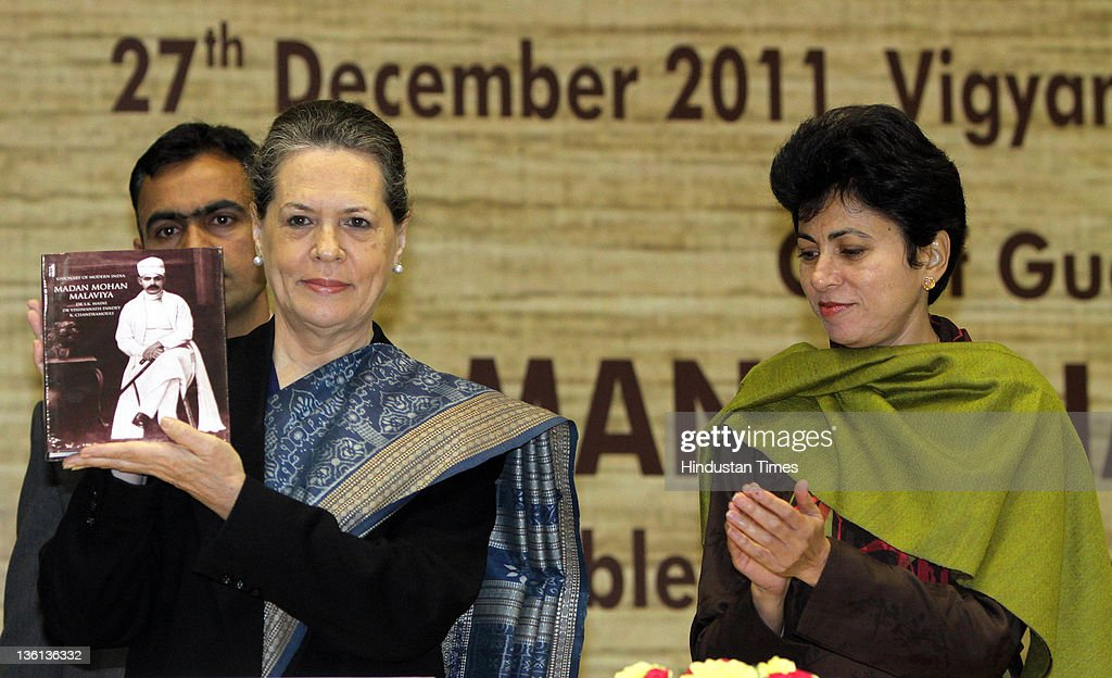 Chairperson Sonia Gandhi (L) releases a commemorative biography of Mahamana Malaviya as Kumari Selja, Minister of Culture and HUPA looks on during a function to commemorate the 150th Birth Anniversary of Mahamana Madan Mohan Malaviya at Vigyan Bhawan on December 27, 2011 in New Delhi, India. A National Implementation Committee was formed under the chairmanship of Dr. Karan Singh to oversee the implementation of the various events aimed at promoting the ideals of Madan Mohan Malviya. Pandit Madan Mohan Malviya (1861-1946) was a prominent nationalist leader and served 4 times as the president of Indian National Congress. He also founded the Banaras Hindu University with Anne Besant.