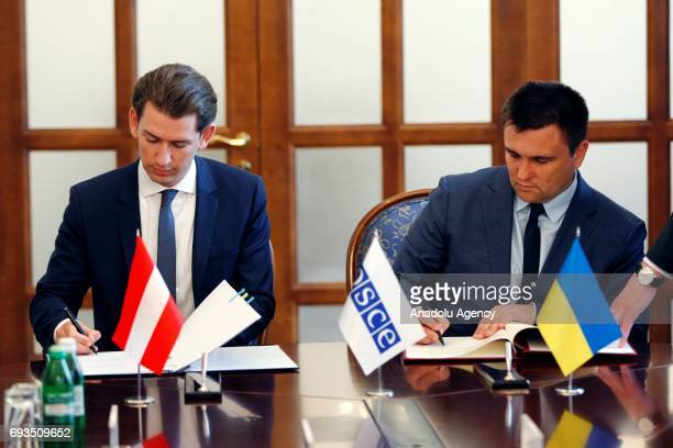 ChairpersoninOffice of the OSCE Austrian Foreign Minister Sebastian Kurz and Ukrainian Foreign Minister Pavlo Klimkin attend the signing ceremony...
