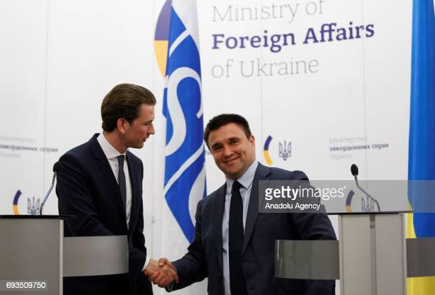 ChairpersoninOffice of the OSCE Austrian Foreign Minister Sebastian Kurz and Ukrainian Foreign Minister Pavlo Klimkin shake hands as they pose for a...
