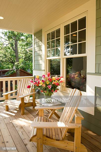 Chairs and flowers on home front porch.