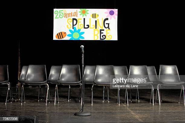 Chairs and microphone on empty stage, for spelling bee competition