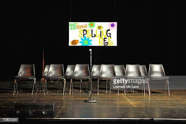 Chairs and microphone on empty stage