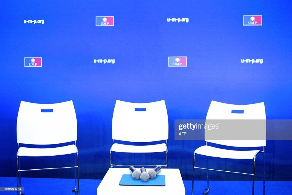 Chairs and microphones are prepared prior to a press conference of French UMP opposition right-wing party President after a meeting of the political committee, at the UMP headquarters on December 19, 2012 in Paris. Jean-Francois Cope and former Prime Minister Francois Fillon, the rivals in the leadership row which split French former ruling party, the UMP, agreed on December 17, 2012 to a new internal election after a bitterly-contested first vote last month.