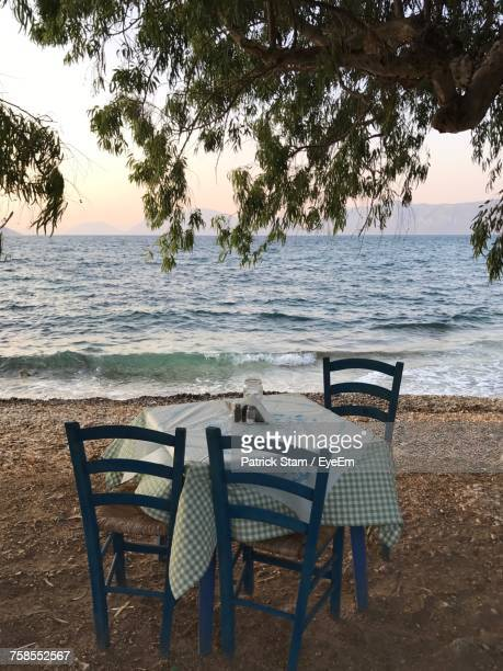 Chairs And Table On Shore By Sea