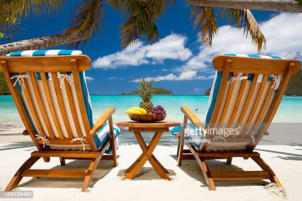 chairs and table with fruit at a tropical Caribbean beach