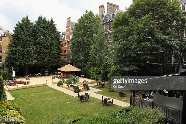 Chairs and tables are set up in the garden of the Goring Hotel in Victoria on June 9 2011 in London England The garden of the Goring Hotel where...
