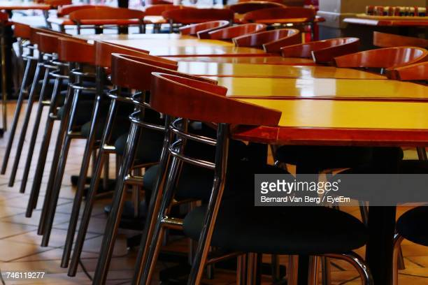 Chairs And Tables Arranged In Cafeteria