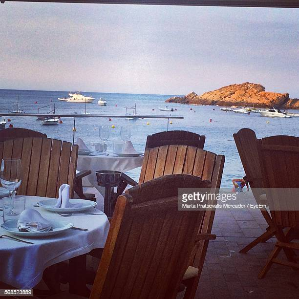 Chairs And Tables At Seaside Restaurant