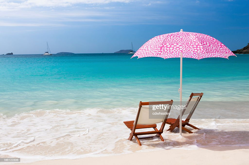 chairs and umbrella at a beach in the Caribbean