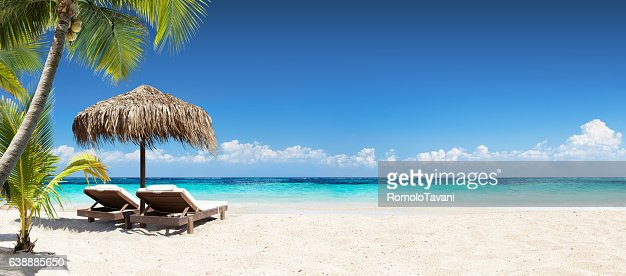 Chairs And Umbrella In Coral Beach - Tropical Resort Banner : Stock Photo