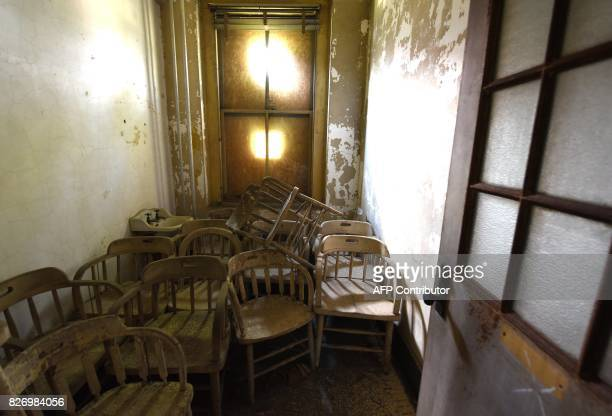 Chairs are piled in a room in one of the buildings of the The Ellis Island Hospital on August 5 a 750bed facility which treated over 12 million...