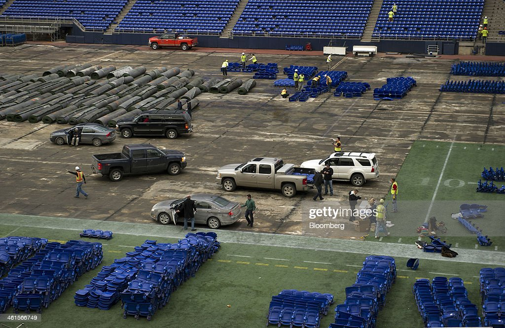 Chairs are piled up near rolls of synthetic turf during the demolition of the Hubert H. Humphrey Metrodome in Minneapolis, Minnesota, U.S., on Tuesday, Jan. 7, 2014. The new stadium is expected to generate development in downtown Minneapolis and provide a venue for national events such as the Super Bowl, said Michele Kelm-Helgen, chair of the Minnesota Sports Facilities Authority, which is overseeing the project at the site of the existing Metrodome. Photographer: Matthew Hintz/Bloomberg via Getty Images