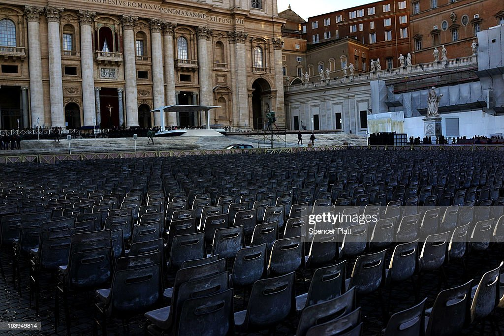 Chairs are positioned for guests in front of St Peter's Basilica as workers prepare for the inauguration mass of Pope Francis on March 18, 2013 in Vatican City, Vatican. The Inauguration Mass for Pope Francis will take place on March 19, the feast day for St. Joseph.