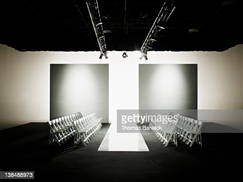 Chairs around catwalk set for fashion show : Stock Photo