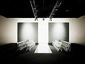 Chairs around catwalk set for fashion show