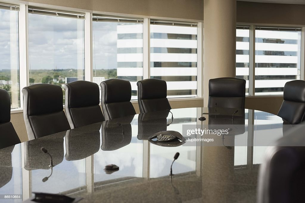 Chairs around table in conference room : Stock Photo
