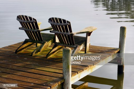 Chairs at sunset on bay
