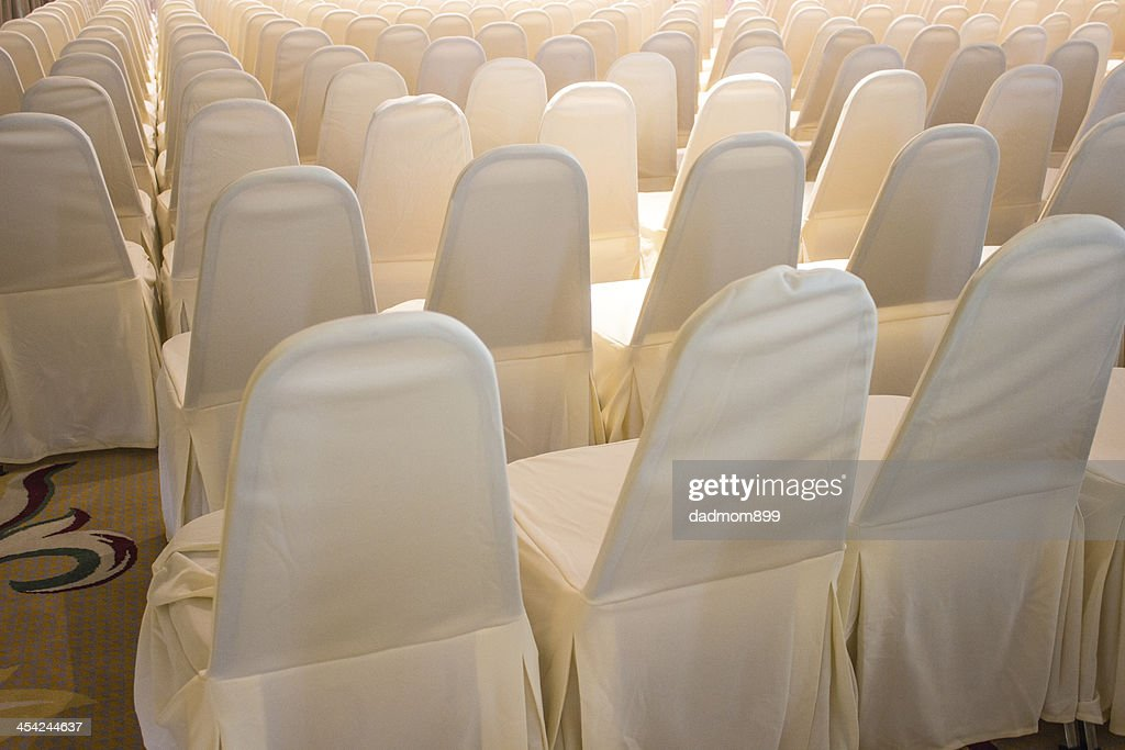 Chairs covered with white cloth : Stock Photo