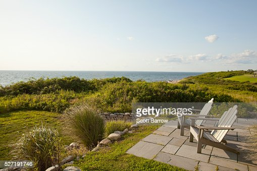 Chairs overlooking a lake : Stock Photo