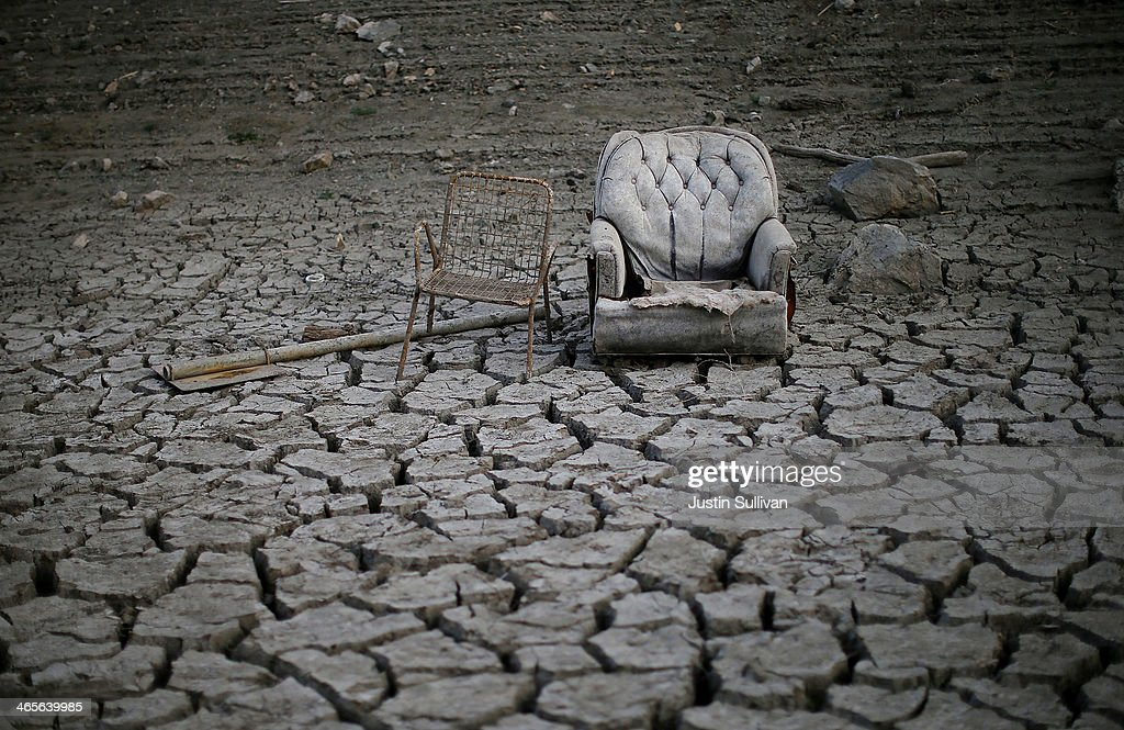 Chairs sit in dried and cracked earth that used to be the bottom of the Almaden Reservoir on January 28 2014 in San Jose California Now in its third...