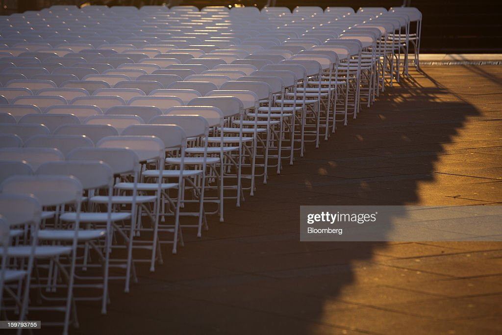 Chairs sit placed in front of the Capitol building ahead of the presidential inauguration in Washington, D.C., U.S., on Sunday, Jan. 20, 2013. As he enters his second term U.S. President Barack Obama has shed the aura of a hopeful consensus builder determined to break partisan gridlock and adopted a more confrontational stance with Republicans. Photographer: Victor J. Blue/Bloomberg via Getty Images