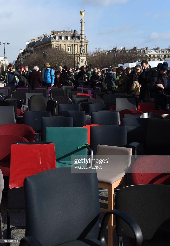 Chairs taken from bank offices are pictured on February 8, 2016 on the pont au change near the Court of Paris during a demonstration against bank system and tax fraud, as former French budget minister Jerome Cahuzac goes on trial on February 8 for tax fraud. Cahuzac resigned in disgrace in 2013 after admitting to having a secret Swiss bank account, and faces up to seven years in jail and two million euros ($2.2 million) in fines. AFP PHOTO / MIGUEL MEDINA / AFP / MIGUEL MEDINA