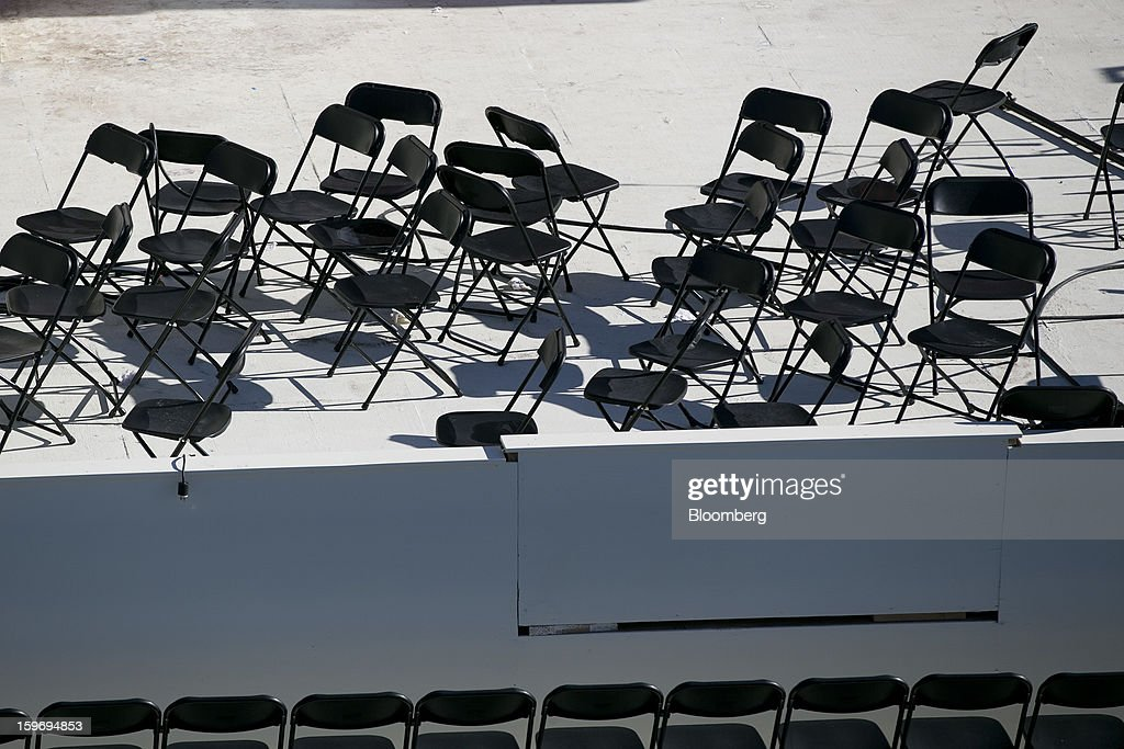 Chairs wait to be positioned outside the U.S. Capitol prior to the second inauguration of U.S. President Barack Obama in Washington, D.C., U.S., on Friday, Jan. 18, 2013. President Obama's second inauguration next week will combine the star power of Beyonce, Kelly Clarkson and James Taylor with a lineup that reflects social values Obama will champion in his new term. Photographer: Andrew Harrer/Bloomberg via Getty Images
